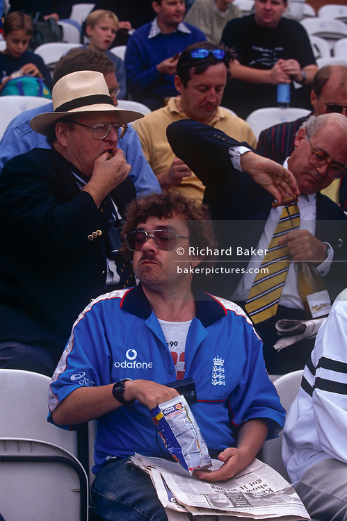 Gentlemen fans of cricket enjoy drinks and a day out during e test match at the Oval, on 21st August 1999, at the Oval ground, south London, England.