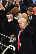 President Donald Trump holds his fists in victory following his Inaugural address after being sworn-in as the 45th President on Capitol Hill January 20, 2017 in Washington, DC.