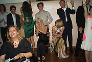 DONATELLA VERSACE AND ANNA WINTOUR WATCHING THE FOOTBALL, Luomo Vogue 40th Anniversary dinner. Palazzo Litta. Milan. 22 June 2008 *** Local Caption *** -DO NOT ARCHIVE-© Copyright Photograph by Dafydd Jones. 248 Clapham Rd. London SW9 0PZ. Tel 0207 820 0771. www.dafjones.com.