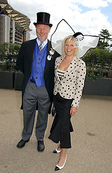 MR CHRIS WRIGHT chairman of the Chrysalis Group and MISS JANICE STINNES the first day of the Royal Ascot racing festival 2006 at Ascot Racecourse, Berkshire on 20th June 2006.<br />