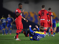 Football - 2020 / 2021 Sky Bet League One - AFC Wimbledon vs Wigan Athletic - Plough Lane<br /> <br /> Wigan Athletic's Tendayi Darikwa with AFC Wimbledon's Joe Pigott at the final whistle.<br /> <br /> COLORSPORT/ASHLEY WESTERN