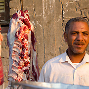 Village butcher in the evening sun. Dahab Island, Cairo.