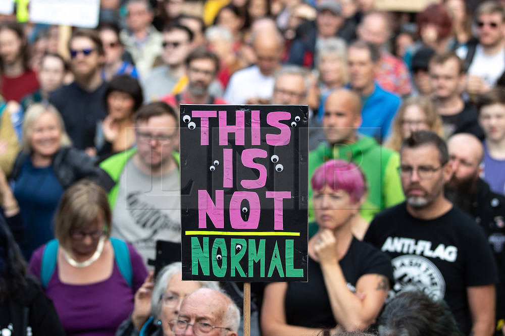 """© Licensed to London News Pictures. 31/08/2019. Manchester, UK. A placard reading """" This is not normal """" .Thousands attend a pro EU demo in Albert Square Manchester City Centre , with objections raised to the Prime Minister Boris Johnson's intention to prorogue Parliament in the run up to Britain's planned Brexit deadline . Photo credit: Joel Goodman/LNP"""