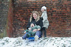 © Licensed to London News Pictures 10/02/2021.        Rochester, UK. Mum Jade, sledging with her son Parker age 2 with a push from daughter Milla age 7 Rochester, Kent. (permission given) Temperatures are set to drop to a freezing cold -7C in Kent and the South East tonight with more snowfall expected. Photo credit:Grant Falvey/LNP