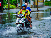 27 MAY 2017 - BANGKOK, THAILAND: A motorcyle taxi with a passenger on Ekkamai Road, flooded by monsoonal rains, in suburban Bangkok. The rainy season in Bangkok usually starts in mid-June but started almost a month early this year. There have been daily thunderstorms and localized flooding throughout central Thailand since the middle of May.     PHOTO BY JACK KURTZ