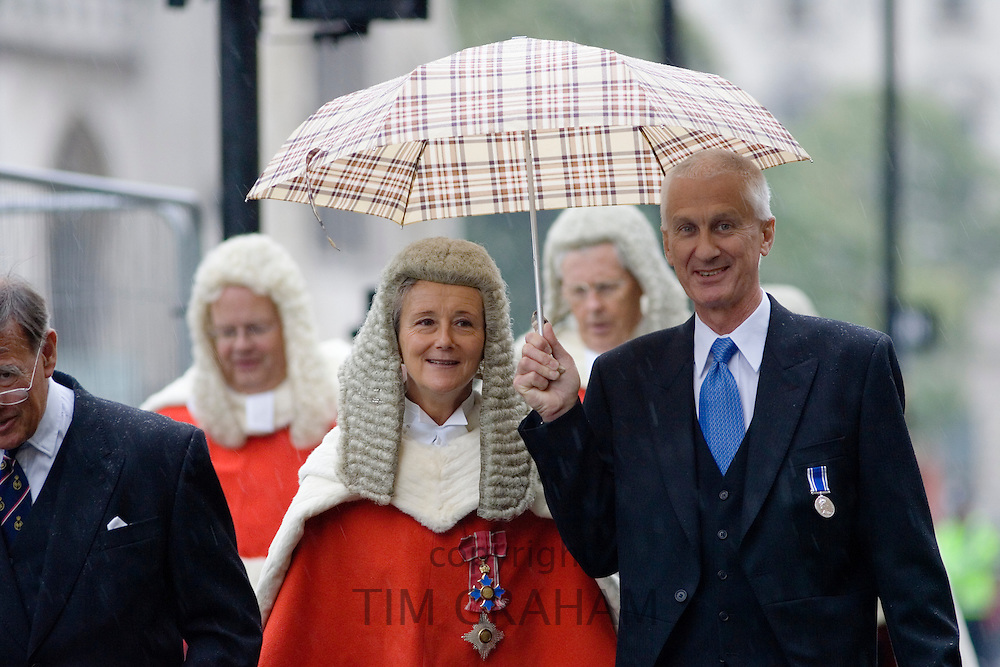 Lady judge sheltered from rain in Judges Procession from Westminster Abbey , London, England, United Kingdom