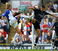 Photo: Paul Thomas.<br /> Blackburn Rovers v Chelsea. The Barclays Premiership. 27/08/2006.<br /> <br /> Robbie Savage (L) of Blackburn and Michael Ballack go for the ball.