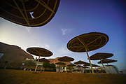 Parasols on the beach of the Dead Sea, Israel