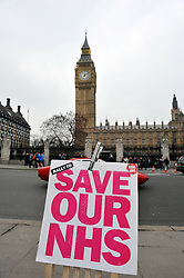Save Our NHS protest sign outside Big Ben, Westminster, London UK.March 2012
