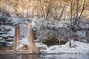 Several frozen waterfalls on sandstone cliff face next to Ķūķu iezis frozen while falling into river Gauja, Gauja National park (Gaujas nacionālais parks), Latvia Ⓒ Davis Ulands | davisulands.com