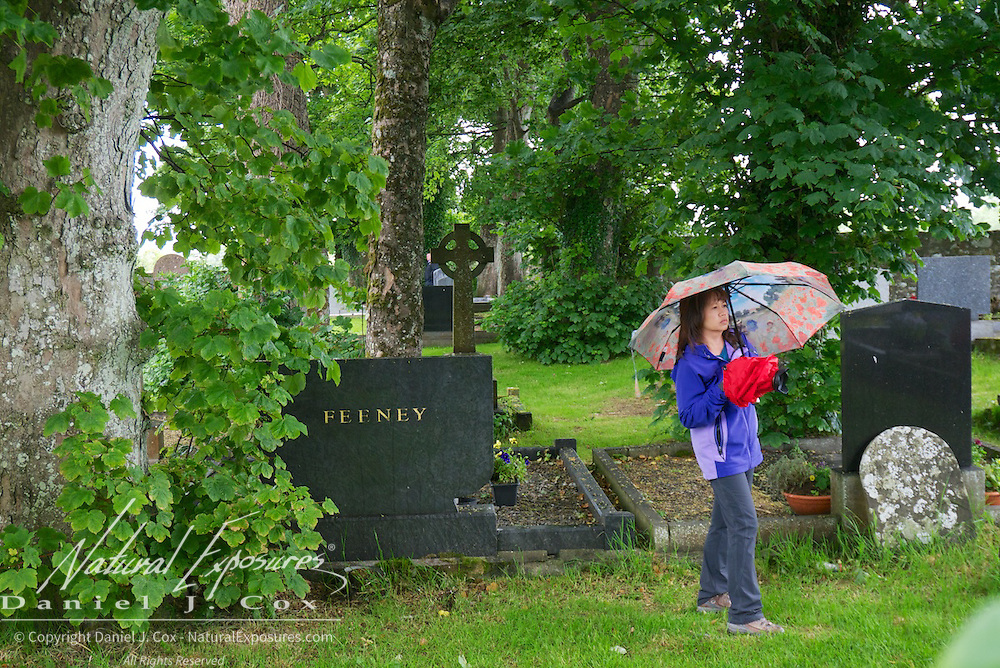 An Vo explores the grounds of the Drumcliffe church, Ireland