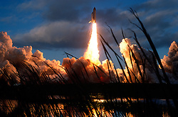 The space shuttle Atlantis lifts off at 7:30 a.m. from launch pad 39-A at the Kennedy Space Center in Florida, on Sunday, Nov. 12, 1995, to begin an eight day mission, highlighted by a docking with the Russian space station Mir. STS-74 was  the fourth mission of the US/Russian Shuttle-Mir Program, and carried out the second docking of a space shuttle to Mir. Atlantis landed back at Kennedy 8 days later. The mission delivered the Russian-built Mir Docking Module to the station along with a pair of solar arrays, and was the second in a series of seven straight missions to the station flown by Atlantis. During the three-day docking, the Russian, Canadian and American astronauts transferred various supplies from Atlantis to Mir, moved several long-term experiments, pieces of equipment and manufactured products from Mir to the Atlantis, and made use of various new pieces of equipment to upgrade Mir, most notably attaching the Docking Module to Mir's Kristall module for use by all of the following docked missions in the Shuttle-Mir Program.