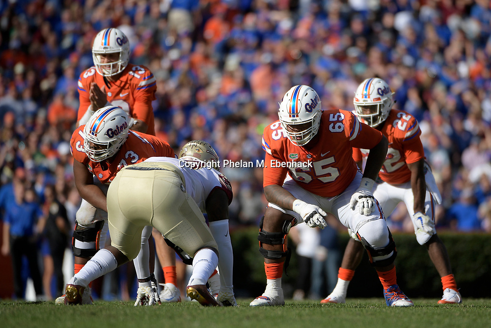 Florida offensive lineman Jawaan Taylor (65) lines up for a play at the line of scrimmage during the second half of an NCAA college football game against Florida State Saturday, Nov. 25, 2017, in Gainesville, Fla. FSU won 38-22. (Photo by Phelan M. Ebenhack)