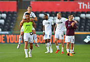 Goalscorer Courtney Baker-Richardson (46) of Swansea City gives a piggyback to Tom Carroll (14) of Swansea City at full time as they celebrate the 3-0 win over QPR during the EFL Sky Bet Championship match between Swansea City and Queens Park Rangers at the Liberty Stadium, Swansea, Wales on 29 September 2018.