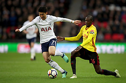 Tottenham Hotspur's Son Heung-Min (left) and Watford's Abdoulaye Doucoure battle for the ball during the Premier League match at Wembley Stadium. London.