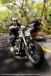 Mike Hendriks riding his 1976 CB550 Honda through Tomoka State Park during Daytona Bike Week. FL. USA. Sunday March 18, 2018. Photography ©2018 Michael Lichter.