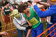 Dressed as Yoda to celebrate Halloween and cheer runners as they cross the finish at the Vermont Principals Association Cross Country Championship at Thetford Academy, Marty Jacobs, of Thetford, lends a hand to Ethan Dean, of Colchester, Saturday, October 31, 2015. (Valley News - James M. Patterson)<br /> Copyright © Valley News. May not be reprinted or used online without permission. Send requests to permission@vnews.com.