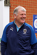 AFC Wimbledon manager Glyn Hodges arriving and laughing during the The FA Cup match between AFC Wimbledon and Doncaster Rovers at the Cherry Red Records Stadium, Kingston, England on 9 November 2019.