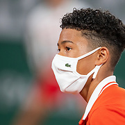 PARIS, FRANCE October 03. A ball boy wearing a mask on Court Philippe-Chatrier during the French Open Tennis Tournament at Roland Garros on October 3rd 2020 in Paris, France. (Photo by Tim Clayton/Corbis via Getty Images)