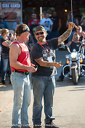 Jay Allen and Chris Callen work the weenie bite contest at the Broken Spoke Saloon during Laconia Motorcycle Week 2016. Laconia, NH, USA. Wednesday, June 15, 2016.  Photography ©2016 Michael Lichter.