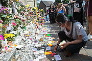 Flowers and candles outside Notting Hill Methodist church as people pay respect to the victims of Grenfell Tower on 17th June 2017 in North Kensington, London, United Kingdom. The Grenfell Tower fire occurred on 14th June 2017 at the 24-storey block of public housing flats in North Kensington, West London. It caused at least 80 deaths and over 70 injuries, yet the actual numbers have yet to be confirmed