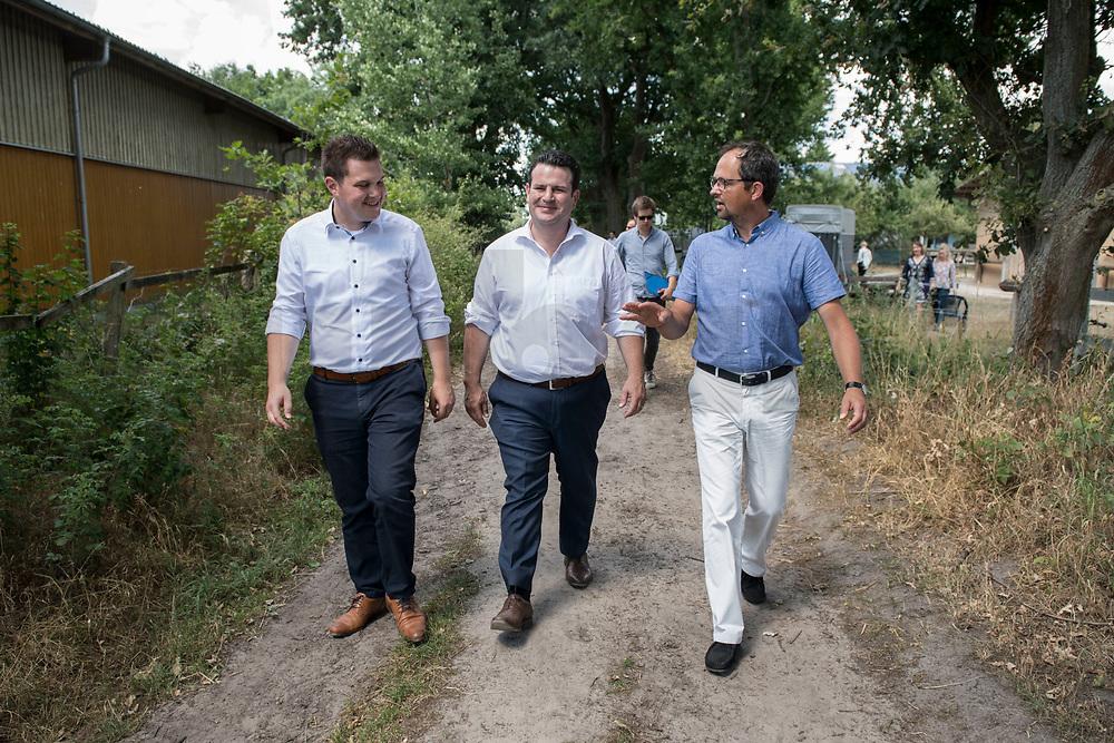 17 JUL 2018, ISENBUETTEL/GERMANY:<br /> Philipp Raulfs, MdL, SPD, Hubertus Heil, SPD, Bundeminister fuer Arbeit und Soziales, und Roland Bursian, Geschaeftsfuehrer DER HOF, (v.L.n.R.), wahrend dem BEsuch des integrativen Bauernhofs DER HOF, im Rahmen der Sommerreise von Hubertus Heil<br /> IMAGE: 20180717-01-076<br /> KEYWORDS: Isenbüttel