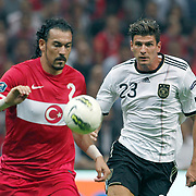 Turkey's Servet CETIN (L) and Germany's Mario GOMEZ (R) during their UEFA EURO 2012 Qualifying round Group A matchday 19 soccer match Turkey betwen Germany at TT Arena in Istanbul October 7, 2011. Photo by TURKPIX