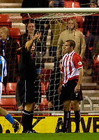 Photo. Jed Wee.<br /> Sunderland v Huddersfield Town, Carling Cup 2nd Round, Stadium of Light, Sunderland. 23/09/2003.<br /> To compound Sunderland's misery, Ben Clark is given his marching orders by referee M Cooper.