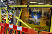 Scaffolding padding and the window display for international shipping company DHL, on 19th October 2017, in London, England.