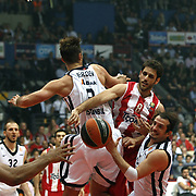 Olympiacos's Efstratios Perperoglou (2ndR) and Anadolu Efes's Kerem Tunceri (R) during their Turkish Airlines Euroleague Basketball playoffs Game 5 Olympiacos between Anadolu Efes at SEF Indoor Hall in Piraeus, in Greece, Friday, April 26, 2013. Photo by TURKPIX