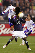10 February 2006: Japan's Yuji Nakazawa (22) jumps over Eddie Johnson (9), of the United States to head home Japan's second goal, and the games final, in stoppage time at the end of the second half. The United States Men's National Team defeated Japan 3-2 at SBC Park in San Francisco, California in an International Friendly soccer match.