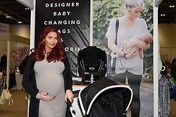 © Licensed to London News Pictures. 03/03/2017. London, UK. Amy Childs, reality TV personality from The Only Way is Essex (TOWIE), visits The Baby Show which has just opened at the Excel Centre in Docklands.  200 exhibitors are presenting their products to new and expectant parents with over 24,000 visitors expected over the weekend. Photo credit : Stephen Chung/LNP