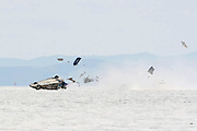 Driver Dies in Speed Week Accident--The Tom Thumb, #216 Coup, driven by Barry Bryant disintegrates as the vehicle rolls near the five-mile marker at the Bonneville Speedway in Utah August 9, 2009. Officials of the Bonneville Nationals report that Bryant, 46, from Anderson, California, died while being transported to a Salt Lake City area hospital. Bryant was traveling approximately 200 mph. at the time of the accident. Photo by Colin E. Braley-Wild West Media