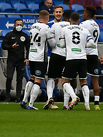 Football - 2020 / 2021 Sky Bet Championship - Cardiff City vs Swansea City - Cardiff City Stadium<br /> <br />  swansea players surround a smiling Joe Ralls of Cardiff City who was later shown a red card as tempers get frayed i the derby natch a stadium without fans because of the pandemic crisis<br /> <br /> COLORSPORT/WINSTON BYNORTH