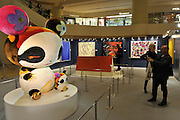 HONG KONG - MARCH 12:  Two visitors take a picture of the sculpture 'Panda geant' by Murakami Takashi, represented by Sotheby's, as part of the exhibition 'The artist's palette' that takes place in the Pacific Place mall on March 12, 2015 in Hong Kong, Hong Kong.  (Photo by Lucas Schifres/Getty Images)