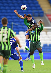 Sean Morrison of Cardiff City tussles with Adebayo Akinfenwa of AFC Wimbledon - Mandatory by-line: Paul Knight/JMP - Mobile: 07966 386802 - 11/08/2015 -  FOOTBALL - Cardiff City Stadium - Cardiff, Wales -  Cardiff City v AFC Wimbledon - Capital One Cup