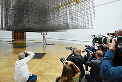 "© Licensed to London News Pictures. 16/09/2019. LONDON, UK.  Antony Gormley RA poses next to his work ""Matrix III"", 2019, viewed by press photographers.  Preview of a new exhibition by Antony Gormley at the Royal Academy of Arts.  The show bring together existing and specially conceived new works from drawing to sculptures to experimental environments to be displayed in all 13 rooms of the RA's Main Galleries 21 September to 3 December 2019.  Photo credit: Stephen Chung/LNP"