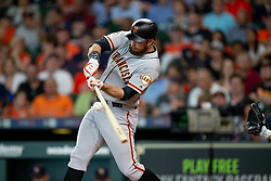 May 23, 2018 - Houston, TX, U.S. - HOUSTON, TX - MAY 23: San Francisco Giants first baseman Brandon Belt (9) makes contact for a single in the fourth inning during MLB baseball game between the Houston Astros and the San Francisco Giants on May 23, 2018 at Minute Maid Park in Houston, Texas. (Photo by Juan DeLeon/Icon Sportswire) (Credit Image: © Juan Deleon/Icon SMI via ZUMA Press)