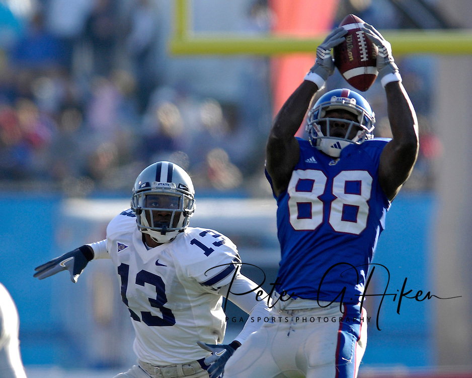 University of Kansas wide receiver Dexton Fields (88) pulls in a pass in the first half in front of Kansas State defensive back Joshua Moore (13) at Memorial Stadium in Lawrence, Kansas, November 18, 2006.  Kansas beat K-State 39-20.<br />