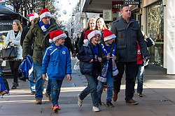 © Licensed to London News Pictures. 20/12/2014. London, UK. A family with young boys wearing Santa Hats shopping on London's Oxford Street on the last saturday before Christmas. Photo credit : Richard Isaac/LNP