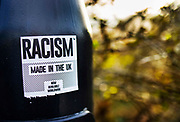 An ironic sticker inferring that racism started in Britain on 21st February 2021 in London, United Kingdom.