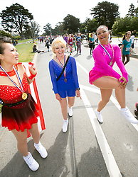 Three women costumed as Olympic figure skaters Kristi Yamaguchi, from left, Tonya Harding and Nancy Kerrigan clown for the camera at the 107th running of the Bay to Breakers, Sunday, May 20, 2018, in San Francisco. (Photo by D. Ross Cameron)