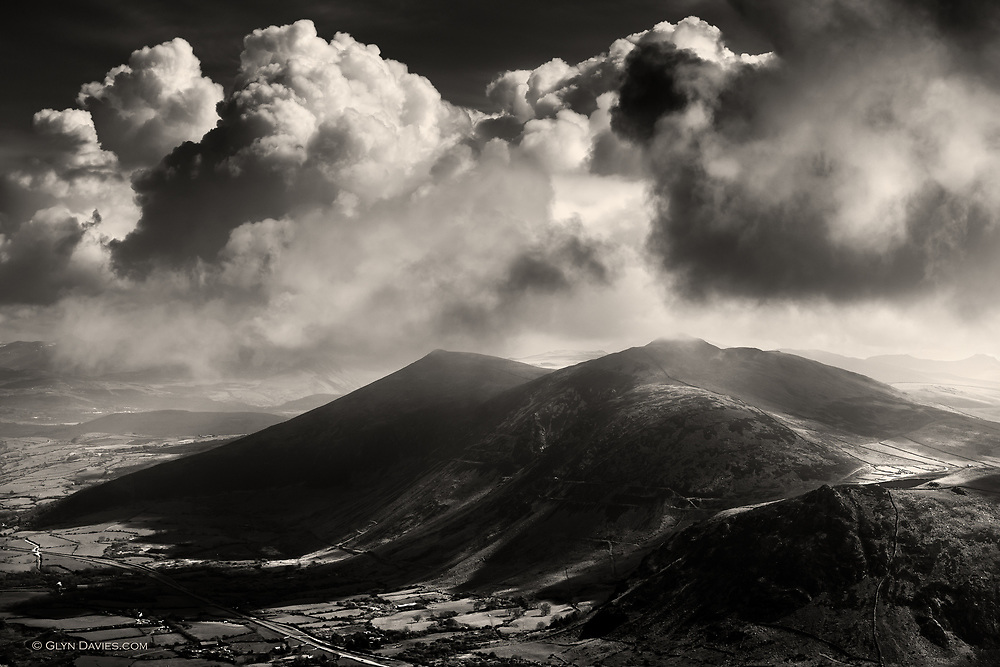 An early morning shoot from the hills of Yr Eifl on North Wales most Western tip, the Lleyn Peninisula. The clouds were stormy looking and threatening rain, but the sunlight between showers was crisp and beautiful and sculptural.