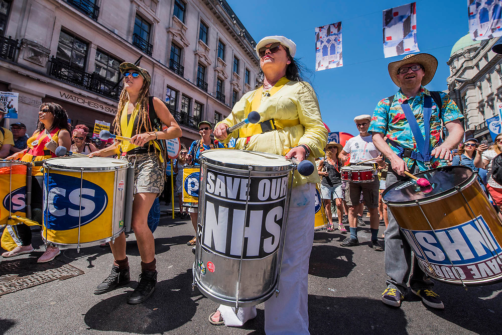 The PCS drum band - #OurNHS70: free, for all, forever a protest and celebration march in honour of the 70 year history of the National Health Service. Organised by: The People's Assembly, Trades Union Congress, Unison, Unite, GMB, British Medical Association, Royal College of Nursing, Royal College of Midwives amongst others.