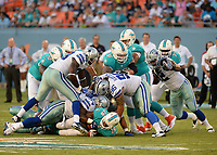 August 23rd, 2014, Miami Dolphins running back Lamar Miller (26) during a game between the Miami Dolphins and the Dallas Cowboys at Sun Life Stadium in Miami Garden, FL NFL American Football Herren USA AUG 23 Preseason - Cowboys at Dolphins PUBLICATIONxINxGERxSUIxAUTxHUNxRUSxSWExNORxONLY Icon140823026<br /> <br /> August 23rd 2014 Miami Dolphins Running Back Lamar Miller 26 during A Game between The Miami Dolphins and The Dallas Cowboys AT Sun Life Stage in Miami Garden Fl NFL American Football men USA Aug 23 Preseason Cowboys AT Dolphins PUBLICATIONxINxGERxSUIxAUTxHUNxRUSxSWExNORxONLY