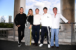Robbie Williams, Ayda Field, Dermot O'Leary, Louis Tomlinson and Simon Cowell attending the X Factor photocall held at Somerset House, London.