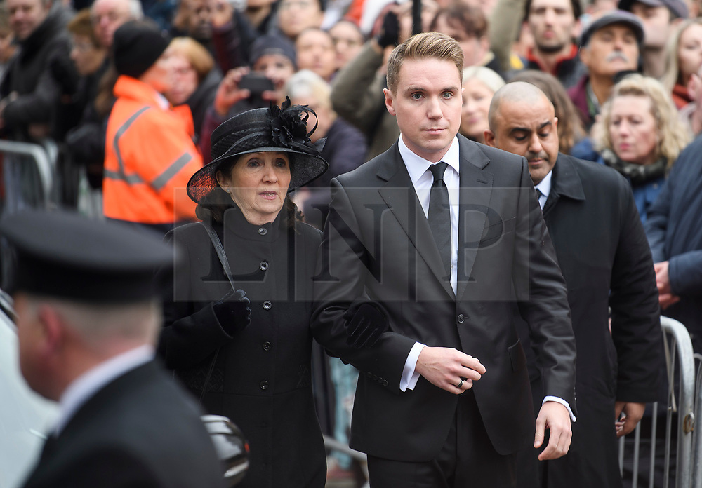 © Licensed to London News Pictures. 31/03/2018. Cambridge, UK. JANE HAWKING (former wife) and TIMOTHY HAWKING (son) attend The funeral of Stephen Hawking at Church of St Mary the Great in Cambridge, Cambridgeshire. Professor Hawking, who was famous for ground-breaking work on singularities and black hole mechanics, suffered from motor neurone disease from the age of 21. He died at his Cambridge home in the morning of 14 March 2018, at the age of 76. Photo credit: Ben Cawthra/LNP