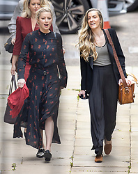 © Licensed to London News Pictures. 15/07/2020. London, UK. American actor AMBER HEARD (L) arrives with sister Whitney Heard at the High Court in London where Johnny Depp is in a legal dispute with UK tabloid newspaper The Sun over allegations he assaulted his former wife, Amber Heard. Photo credit: Peter Macdiarmid/LNP