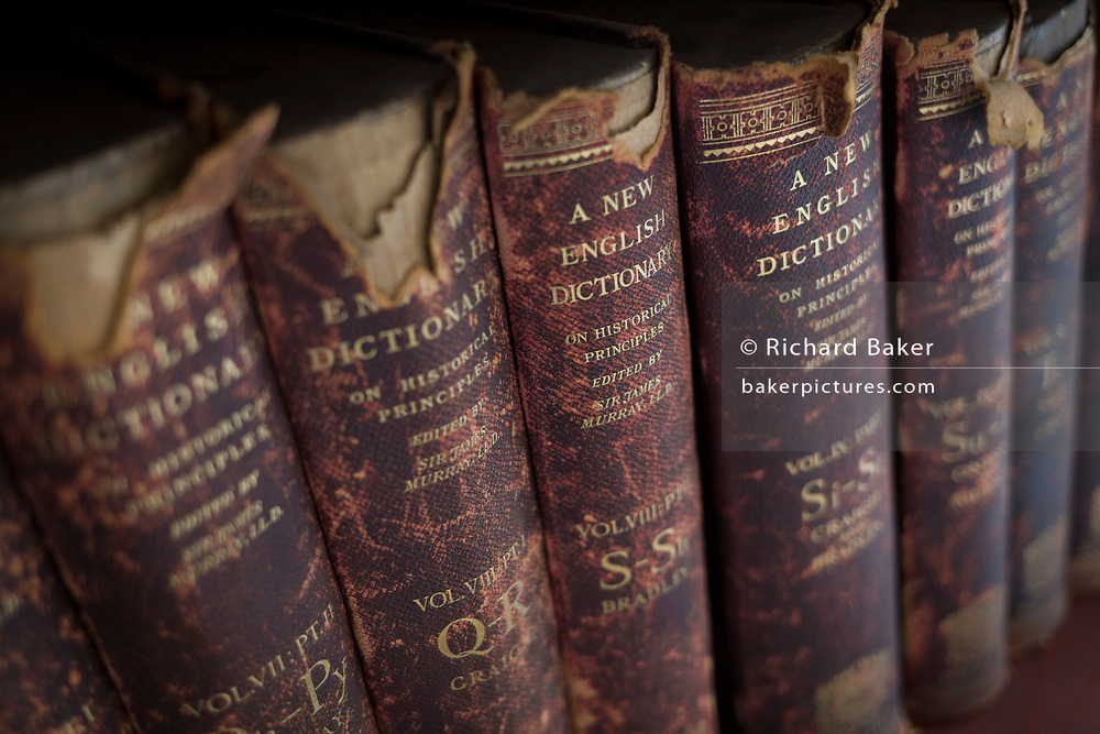 Antiquarian copies of The New English Dictionary on Historical Principles edited by Sir James Murray, line shelves in the Lee Library of the British Academy, on 17th September 2017, at 10-12 Carlton House Terrace, in London, England. Sir James Augustus Henry Murray (1837-1915) was a Scottish lexicographer and philologist. He was the primary editor of the Oxford English Dictionary (OED) from 1879 until his death.