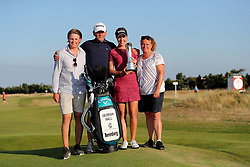 England's Georgia Hall with mum, dad and boyfriend with the trophy after she wins the Ricoh Women's British Open at Royal Lytham & St Annes Golf Club.